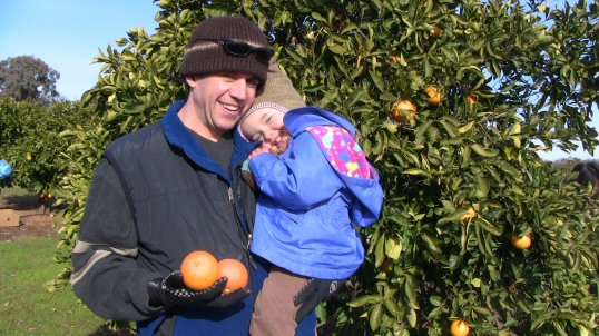 Grant & Lily in the orange orchard