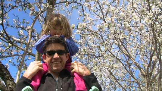 Shoulder-ride in the almond blossoms